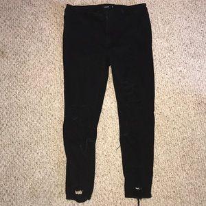 Black holy skinny jeans